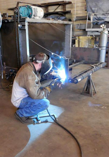 Former job seeker now working in a welding shop with assistance from LAMB Labor Services